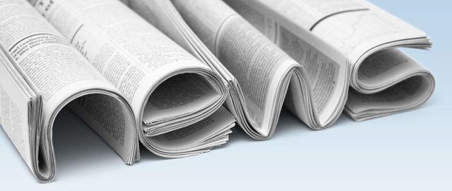 """vier Zeitungen formen das Wort """"news"""""""